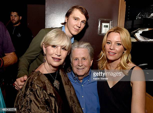 Melinda Ledbetter Wilson actor Paul Dano musician Brian Wilson and actress Elizabeth Banks pose backstage at Roadside Attraction's Love and Mercy DVD...