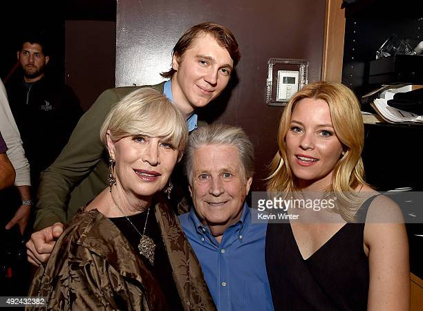 """Melinda Ledbetter Wilson, actor Paul Dano, musician Brian Wilson and actress Elizabeth Banks pose backstage at Roadside Attraction's """"Love and Mercy""""..."""