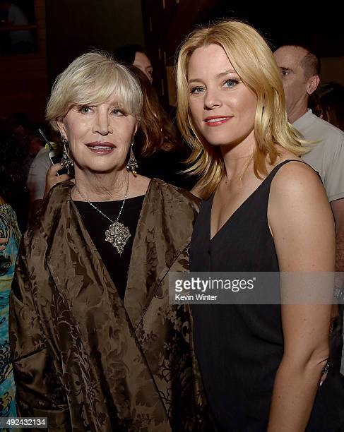 """Melinda Ledbetter Wilson and actress Elizabeth Banks pose at Roadside Attraction's """"Love and Mercy"""" DVD release and music celebration with Brian..."""