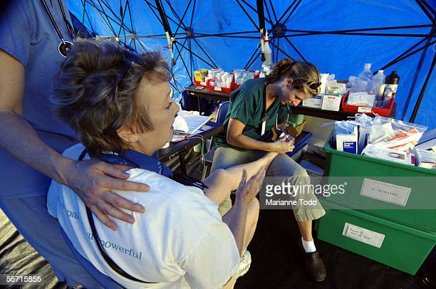 Melinda Tucker a New Orleans attorney whose home in Waveland was destroyed by Hurricane Katrina goes through triage for an injured foot on September...