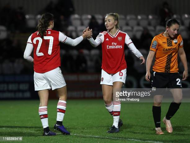 Melisa Filis of Arsenal celebrates with teammate Leah Williamson of Arsenal after scoring her team's seventh goal goal during the FA Women's...