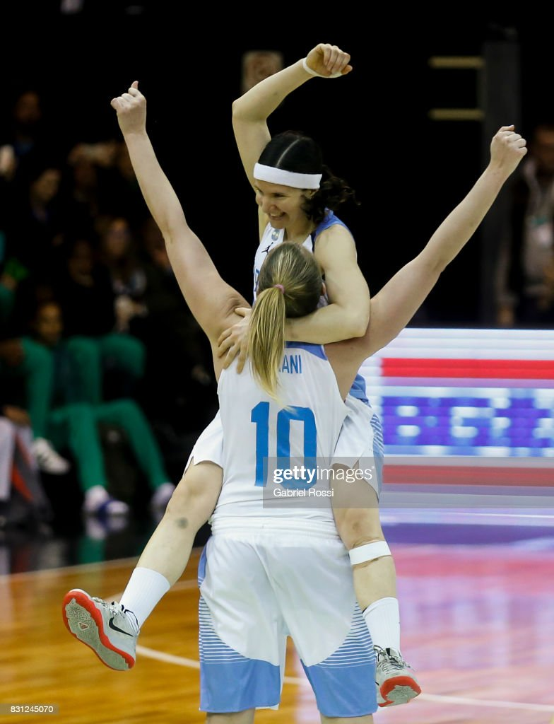 Melisa Gretter of Argentina and Agostina Burani of Argentina celebrate after winning the match between Argentina and Puerto Rico as part of the FIBA Women's AmeriCup Semi Final at Obras Sanitarias Stadium on August 12, 2017 in Buenos Aires, Argentina.