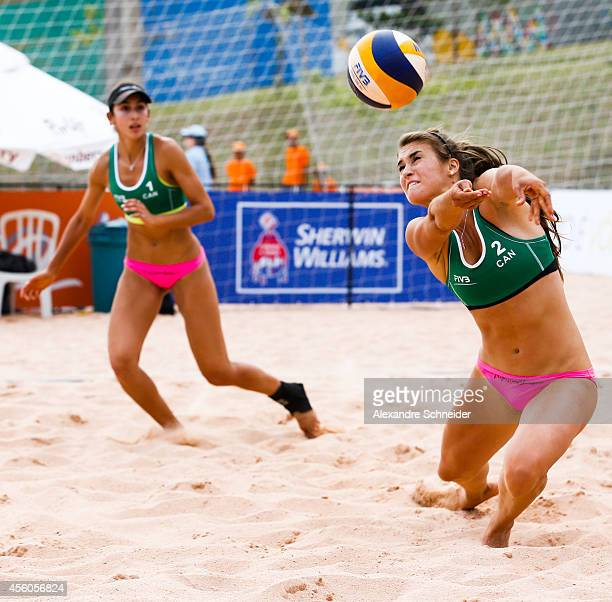 Melisa Parades and Taylor Pischke of Canada compete in the main draw match against United States at Jose Correa Gymnasium during day two of the FIVB...