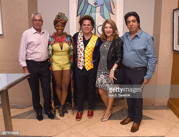 Melissa A Mitchell and Romero Britto pose with guests at Underwater Dreams To Life In Color Art Exhibit Featuring Antonio Dominguez De Haro And...