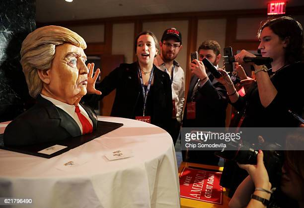 Melissa Alt speaks about a cake in the shape of Republican presidential nominee Donald Trump's head during his election night event at the New York...