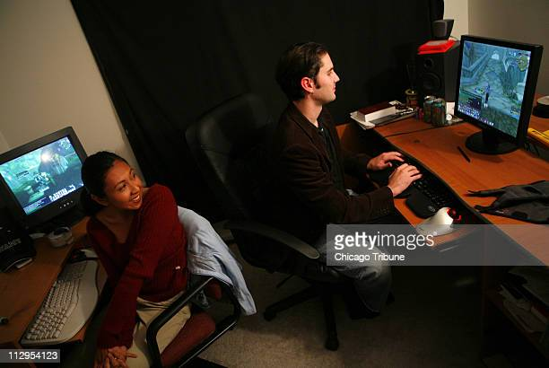 """Melissa and Hudson Akridge in their Hainesville, Illinois, home, where they meet friends online to play World of Warcraft. Hudson, whose """"ninja mage""""..."""