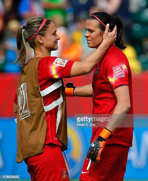 Melissa Barbieri of Australia consoles goalkeeper Lydia Williams after their 10 loss to Japan in the FIFA Women's World Cup Canada 2015 Quarter Final...