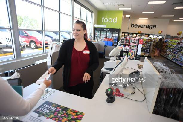 Melissa Bendever of CVS Pharmacy helps a shoppers at the new store on May 30 2017 in Parker Colorado The Parker location is the first standalone CVS...