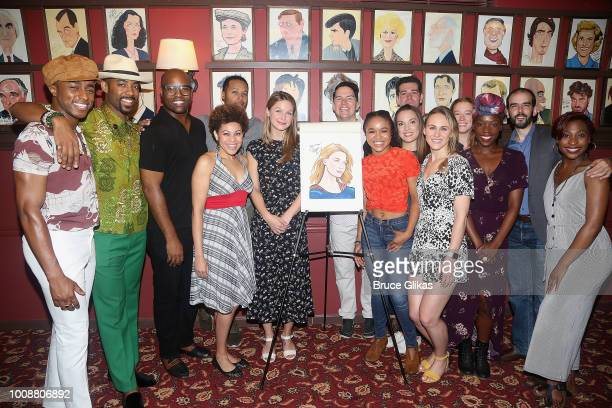 Melissa Benoist poses with the cast as she receives her caricature on the wall honoring her performance in 'BeautifulThe Carole King Musical' at...