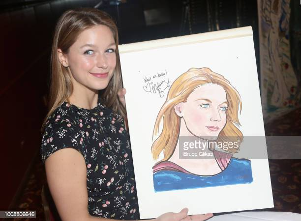 Melissa Benoist receives her caricature on the wall honoring her performance in 'BeautifulThe Carole King Musical' on Broadway at Sardis on July 31...