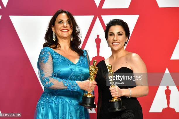 """Melissa Berton and Rayka Zehtabchi pose with the Best Documentary – Short Subject award for """"Period. End of Sentence."""" in the press room during at..."""