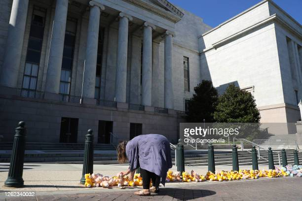 Melissa Byrne of ParentsTogether sets up a 'teddy bear sit in' in front of the Rayburn House Office Building to demand that Amazon founder and CEO...