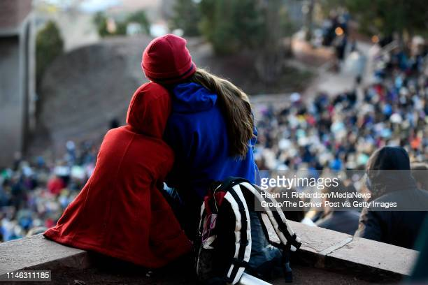 Melissa Campe and her daughter Leia snuggle as they stay warm during Easter sunrise service at Red Rocks Amphiteatre on April 21 2019 in Morrison...