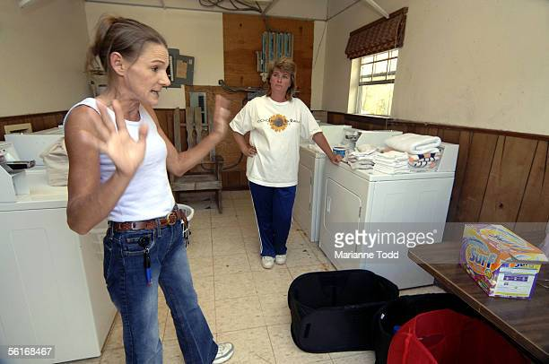 Melissa Cardinale and Elizabeth Dennis of Bay St Louis wait their turn to use the laundry facilities at a FEMA trailer park November 14 2005 in Kiln...