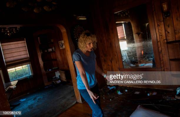 Melissa Christensen reacts at an empty room after a storm surge sucked out most of their belongings in Port St Joe Florida on October 13 three days...