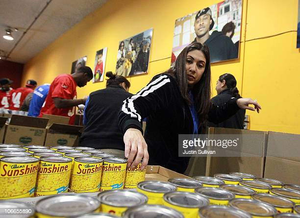 Melissa Correa packs boxes of food while volunteering with members of the San Francisco 49ers at the San Francisco Food Bank on November 9 2010 in...