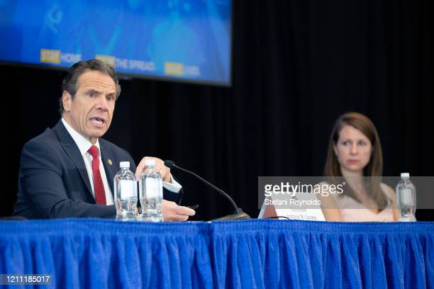 Melissa DeRosa Secretary to the Governor right listens as New York State Governor Andrew Cuomo speaks during his daily Coronavirus press briefing at...