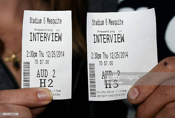 Melissa DeVarona and Dana Canfield of Nevada hold their tickets to see Sony Pictures' 'The Interview' at the Megaplex Theatres Stadium 6 on December...