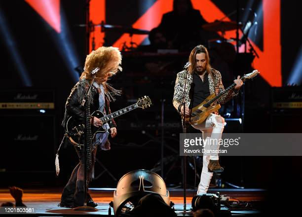 Melissa Etheridge and Nuno Bettencourt perform onstage at MusiCares Person of the Year honoring Aerosmith at West Hall at Los Angeles Convention...