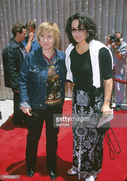 "Melissa Etheridge & Julie Cypher during ""Star Wars Episode I: The Phantom Menace"" Los Angeles Premiere at Avco Cinema in Westwood, California, United..."