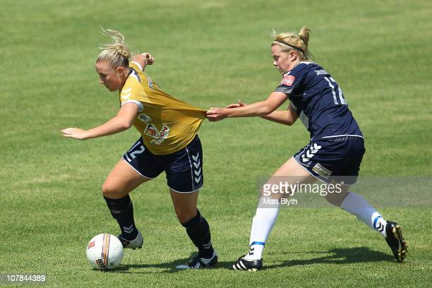 Melissa Feuerriegel of the Jets and Amy Jackson of the Victory compete for the ball during the round eight W-League match between the Newcastle Jets...