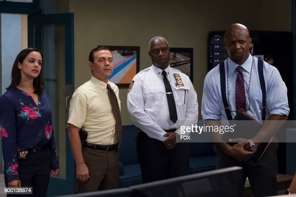 Melissa Fumero Joe Lo Truglio Andre Braugher and Terry Crews in the Game Night Godfather special one hour episode of BROOKLYN NINENINE airing Tuesday...
