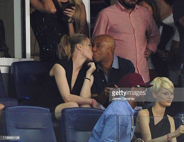 Melissa George and Russell Simmons attend the 2011 MLS AllStars vs Manchester United game at Red Bull Arena on July 27 2011 in Harrison New Jersey