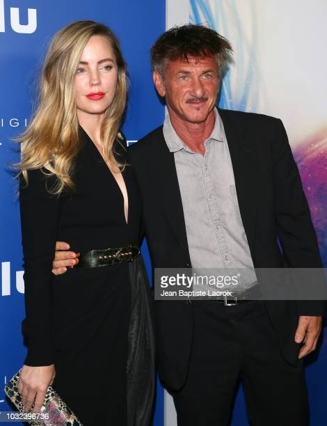 Melissa George and Sean Penn attend the premiere of Hulu's The First on September 12 2018 in Los Angeles California
