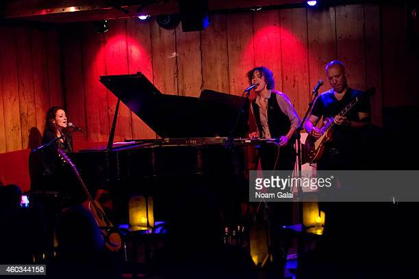 Melissa Giges, Janita and Blake Morgan perform at Rockwood Music Hall on December 11, 2014 in New York City.