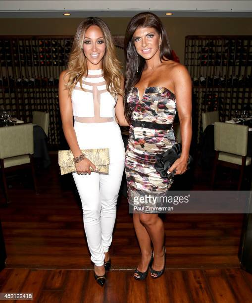 Melissa Gorga and Teresa Giudice attend the 'Real Housewives Of New Jersey' Season Six Premiere Party on July 13 2014 in Parsippany New Jersey