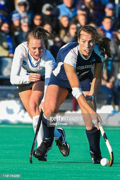 Melissa Gula of Franklin Marshall and Katie George of Middlebury battle for possession during the Division III Women's Field Hockey Championship held...
