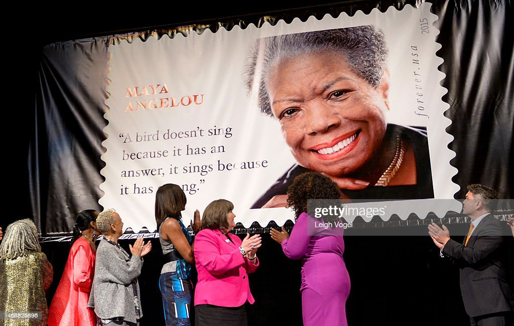 Melissa Harris-Perry, Sophia Nelson, Ethel Kessler, Sonia Sanchez, Eleanor Traylor, Nikki Giovanni, Michelle Obama, Megan J. Brennan, Oprah Winfrey and Ross Rossin view the unveiling of the Maya Angelou Forever Stamp at Warner Theatre on April 7, 2015 in Washington, DC.