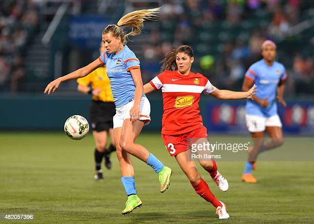 Melissa Henderson of the Houston Dash leaps to control a loose ball in front of Brittany Taylor of the Western New York Flash during the second half...