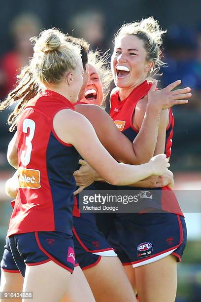 Melissa Hickey of the Demons celebrates a goal with teammates during the round two AFLW match between the Melbourne Demons and the Adelaide Crows at...