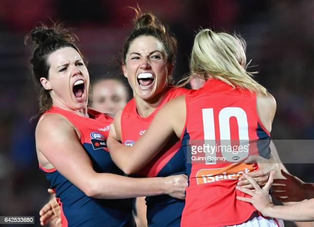 Melissa Hickey of the Demons is congratulated by team mates after kicking a goal during the Women's round three match between the Western Bulldogs...