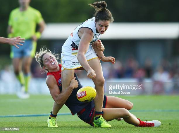 Melissa Hickey of the Demons tackles Angela Foley of the Crows during the round two AFLW match between the Melbourne Demons and the Adelaide Crows at...