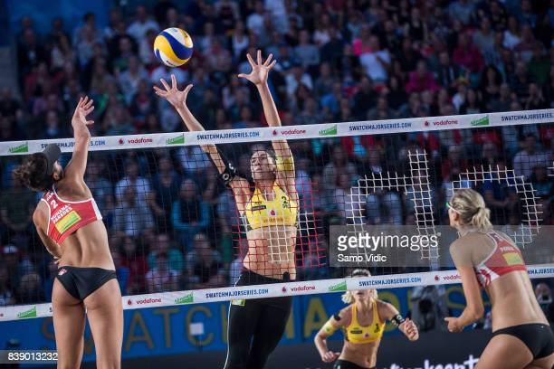 Melissa Humana-Paredes of Canada spikes the ball during the match against Laura Ludwig and Kira Walkenhorst of Germany during Day 3 of the Swatch...