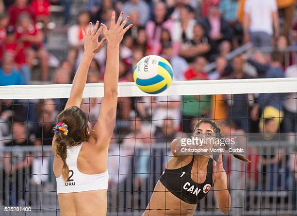 Melissa HumanaParedes of Canada spikes the ball past Fabian Gomez of Uruguay during the the preliminary rounds of beach volleyball competition at the...