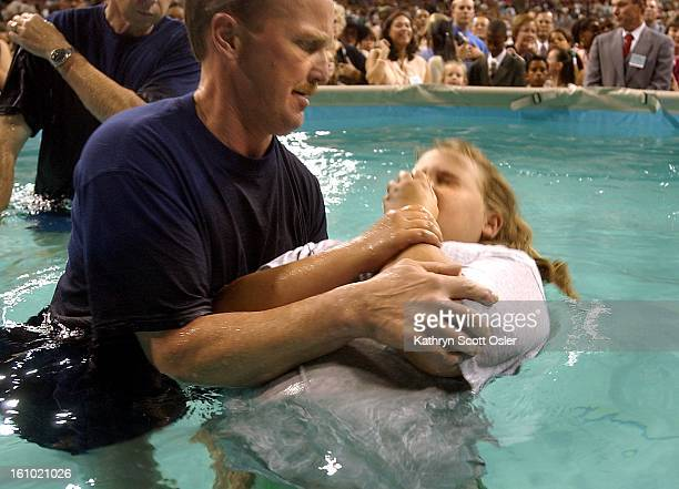 Melissa Johnson of Fort Collins CO is baptized as a Jehovah's Witness with the help of Gary Thompson of Goodland KS during the District Convention of...