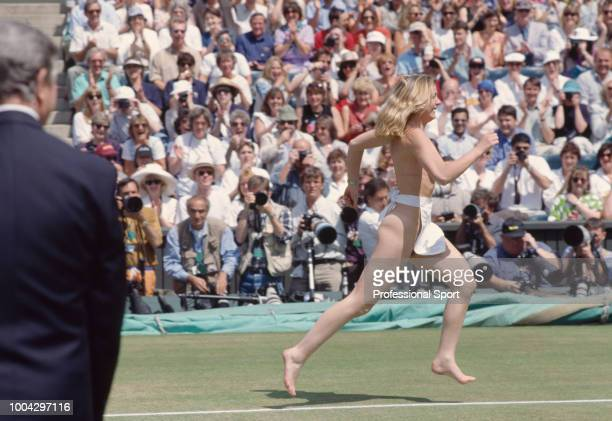 Melissa Johnson streaks across Centre Court during the Men's Singles Final of the Wimbledon Lawn Tennis Championships between Richard Krajicek and...