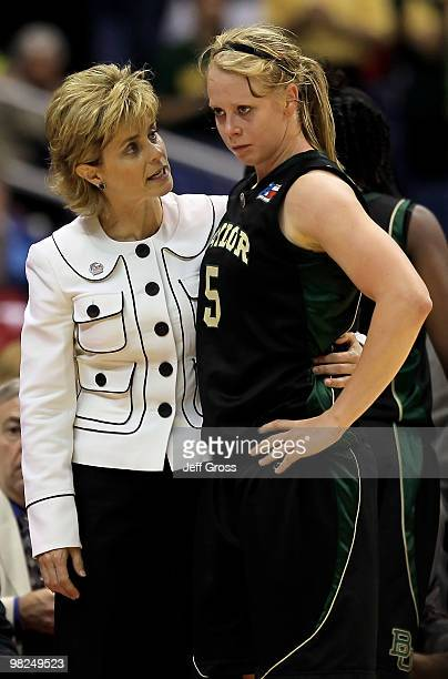 Melissa Jones of the Baylor Bears is consoled by head coach Kim Mulkey after fouling out in the second half against the Connecticut Huskies during...