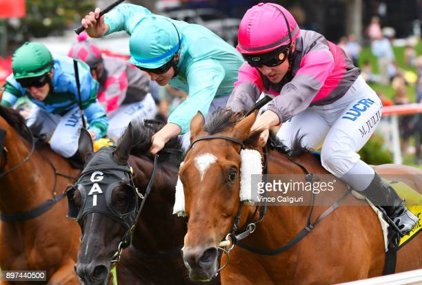 Melissa Julius riding Straight Jacket defeats Zac Spain riding Multitude in Race 4 during Melbourne Racing at Moonee Valley Racecourse on December 23...