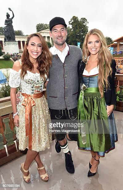 Melissa Khalaj Michael Michalsky and Viviane Geppert during the ProSieben Sat1 Wiesn as part of the Oktoberfest 2016 at Kaefer Tent on September 18...