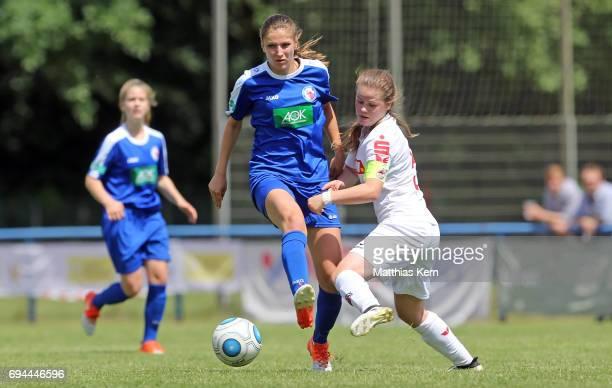 Melissa Koessler of Potsdam battles for the ball with Anna Julia Grassinger of Koeln during the B Junior Girl's German Championship semi final match...