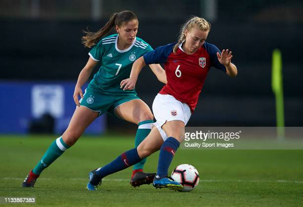 Melissa Kossler of Germany competes for the ball with Vilde Gullhaug Birkeli of Norway during the 14 Nations Tournament match between U19 Women's...