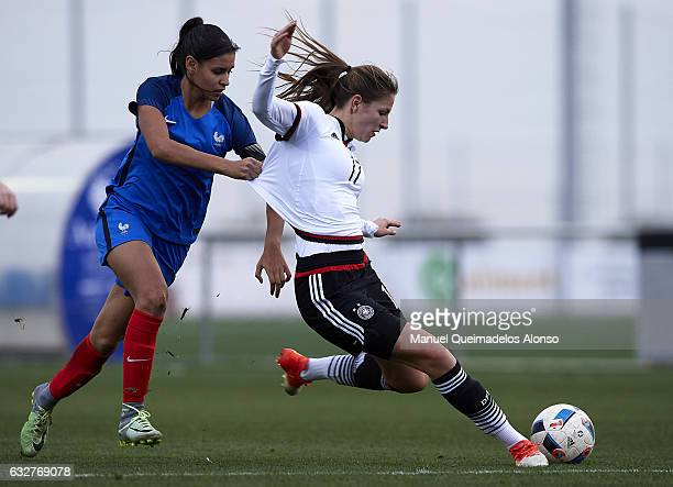 Melissa Kossler of Germany is tackled by Maelle Lakrar of France during the international friendly match between U17 Girl's Germany and U17 Girl's...