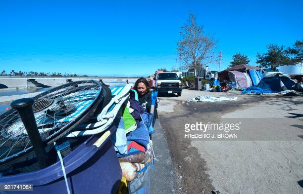 Melissa Lanning pulls her cart of belongings beside the Santa Ana River in Anaheim California on February 20 2018 Officials in Orange County began...