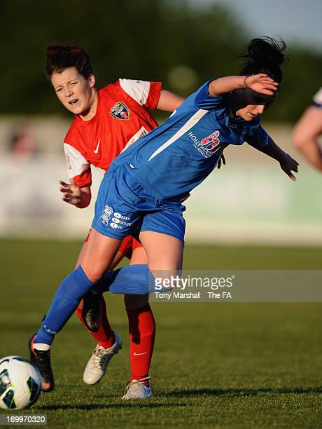 Melissa Lawley of Birmingham City tackled by Angharad James of Bristol Acadamy during The FA Women's Super League match between Birmingham City...