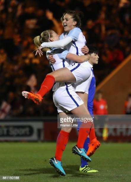 Melissa Lawley of England celebrates scoring the first goal with Keira Walsh of England during the FIFA Women's World Cup Qualifier between England...