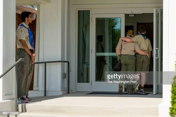 Melissa left in the doorway and and Branimir Udbinac walk into the services for Artem Ziberov at Neelsville Presbyterian Church on June 9 2017 in...